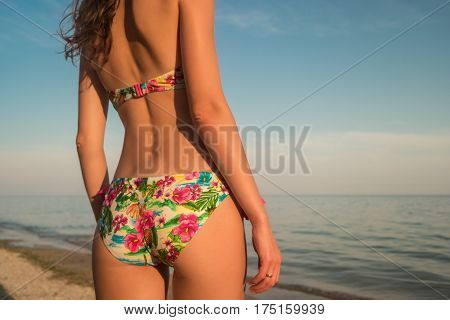 Body of woman in swimsuit. Girl on background of sea. Feel the breeze. Get fit before summer.