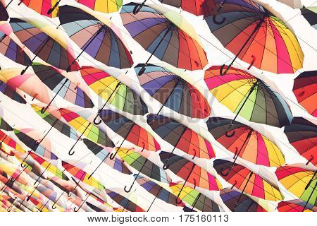 Many bright umbrellas. Open umbrellas isolated. Palette of good mood. Don't be afraid of rain.