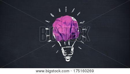 Close-up of crumpled paper ball forming a lightbulb on chalkboard