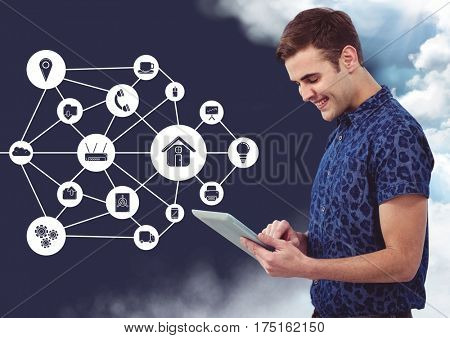 Digital composition of happy man using digital tablet with connecting icons in background