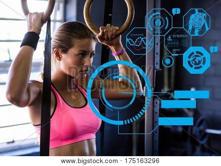 Digital generated image of fit woman exercising in gym with futuristic interface