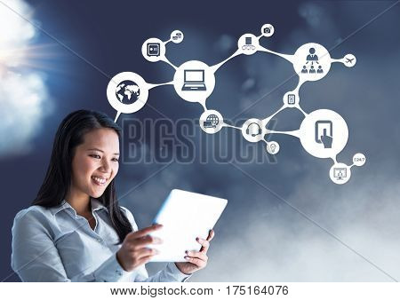 Digital composite of smiling businesswoman using digital tablet against connecting icons