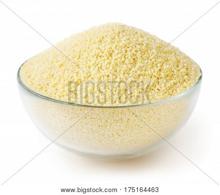 Dry couscous in glass bowl isolated on white background with clipping path