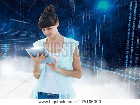 Digital composition of woman using digital tablet with binary codes in background