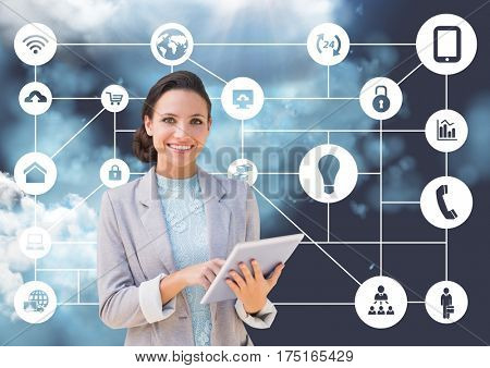 Digital composition of businesswoman holding digital tablet with connecting icons and clouds in background