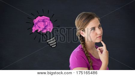 Digital composition of thoughtful woman with crumpled paper on light bulb shape against black background