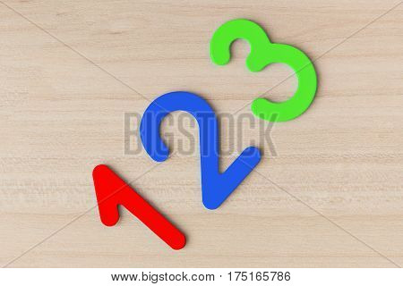Multi-colored number one two and three on a wooden table diagonally