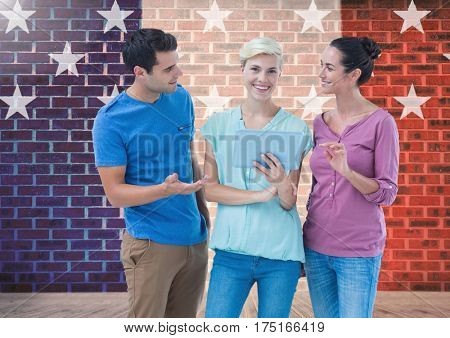 Digital composition of executives discussing over digital tablet against brick wall with star shapes