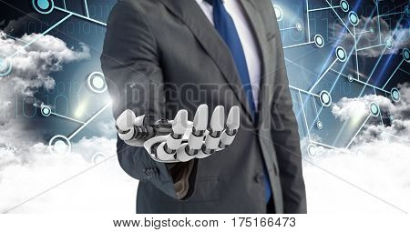 Digital composition of business man with robot hand with clouds in background