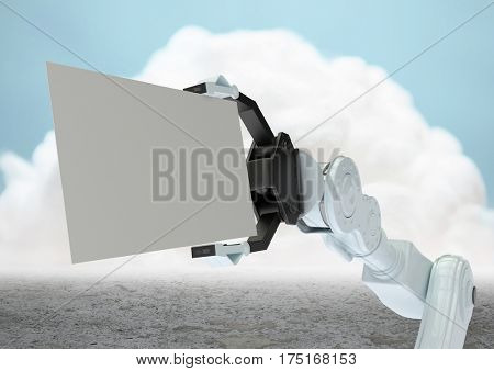 Digital composition of robot claw holding blank card in front of cloud