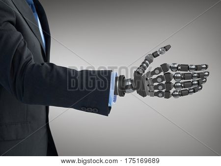Digital composition of business man with robot hand against grey background