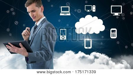 Digital composition of businessman using digital tablet against cloud computing concept in sky