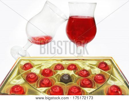 red wine in glass goblets and chocolate sweets