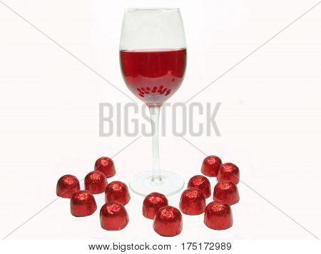 red wine in glass goblet and chocolate sweets