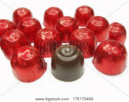 sweetmeats in red casing chocolate sweet food