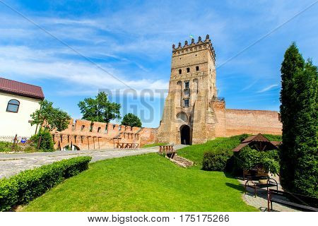 entry in Lutsk castle. summer day there is green grass in front of the castle.
