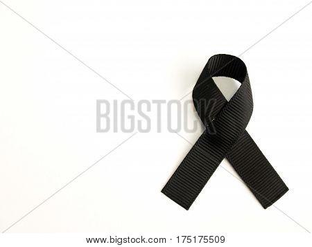 Black ribbon awareness placed on white background