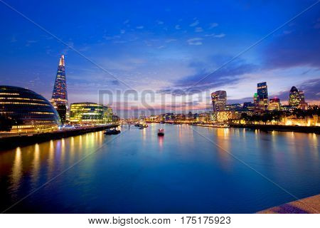 London skyline sunset with City Hall and financial on Thames river