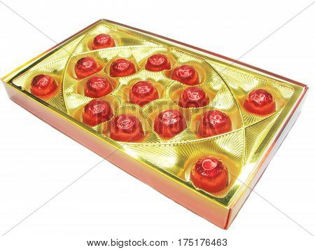 sweetmeats in red casing in gold box