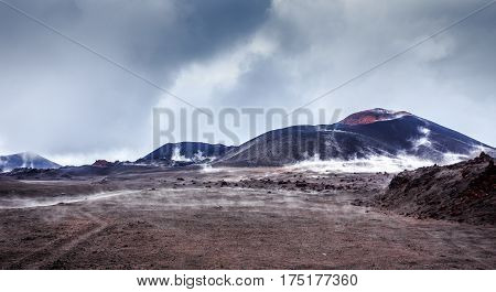 Steaming Lava Valley With Volcanoes Craters In The Background
