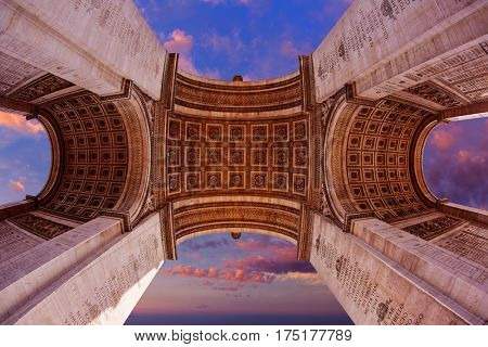 Arc de Triomphe in Paris Arch of Triumph low angle view sunset at France