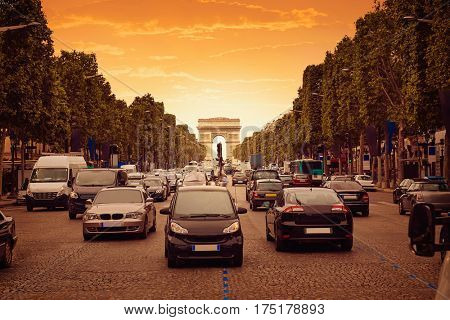 Arc de Triomphe in Paris Arch of Triumph traffic sunset at France
