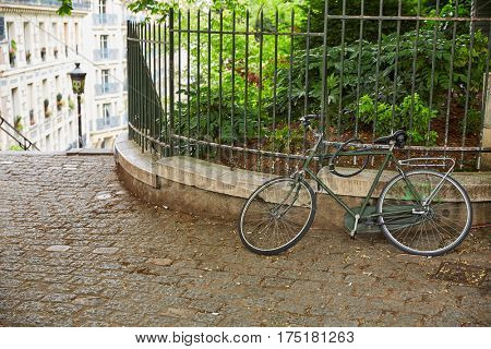 Bicycle chained in Paris Montmartre at France