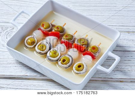 Olives anchovies and pickled onion red pepper pinchos tapas from Spain