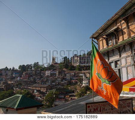 SHIMLA, INDIA. 8 Jun 2009: Houses on the mountain slopes of the Himalayas and the sacred flag. Shimla, Himachal Pradesh, India