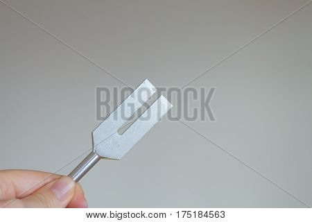tuning fork and crystal on table .