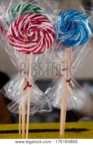 Striped lollipop and multicolored smarties color .