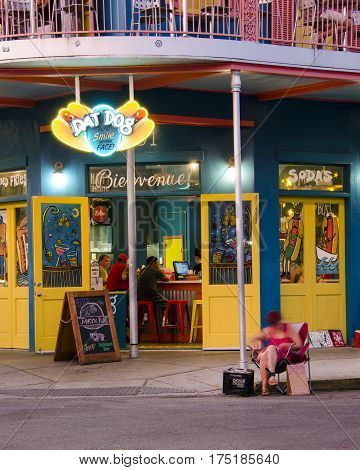 New Orleans, USA - July 13, 2015: Dat Dog restaurant on Frenchmen Street, French Quarter with people eating at the background.