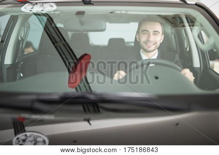 Handsome man driving his car. Driver concept