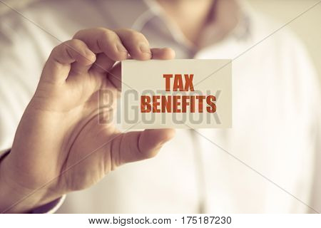 Businessman Holding Tax Benefits Message Card