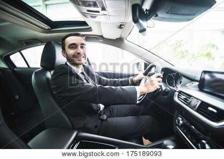 Driving With Pleasure. Close-up Of Cheerful Mature Man In Formalwear Driving Car And Smiling
