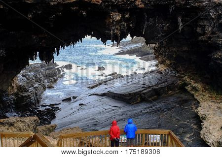 People visit the cave of Admirals Arch on Kangaroo Island South Australia. The island lies in the state of South Australia 112 km (70 mi) southwest of Adelaide. poster