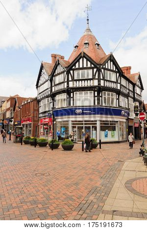 Wrexham Wales UK - May 3 2016: The Welsh border market town of Wrexham one of the largest towns in North East Wales showing the central shopping district on Hope Street