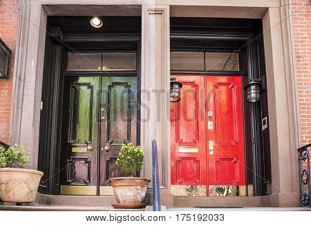 Red and purple doors in a city with front porches