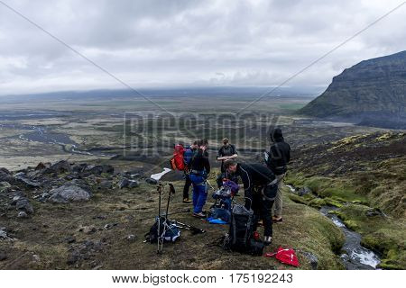 Group Hiking the glacier Hvannadalshnukur highest summit in Iceland mountain volcano landscape Vatnajokull park