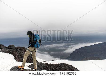 Men Hiking the glacier Hvannadalshnukur highest summit in Iceland mountain landscape Vatnajokull park