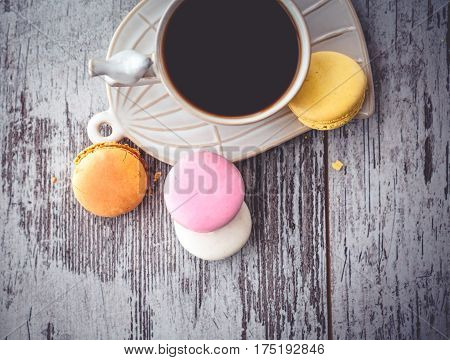 Multicolored Macaroon And White Coffe Cup