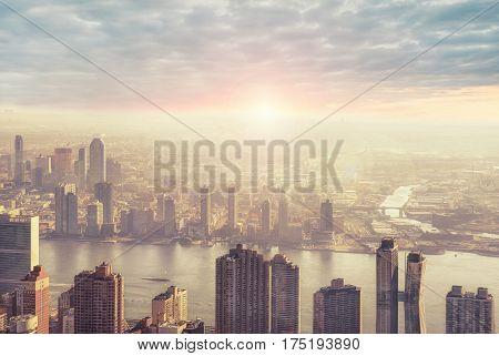 New York city skyline in the morning sunrise in background.