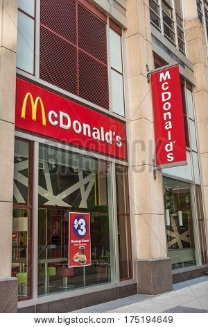 Chicago, USA - May 30, 2016: Two McDonalds signs and logos in downtown city with golden arches