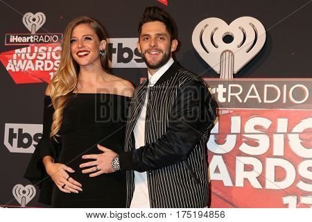LOS ANGELES - MAR 5:  Lauren Gregory, Thomas Rhett at the 2017 iHeart Music Awards at Forum on March 5, 2017 in Los Angeles, CA