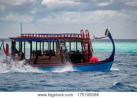 Maldivian Dhoni Boat In Blue Ocean