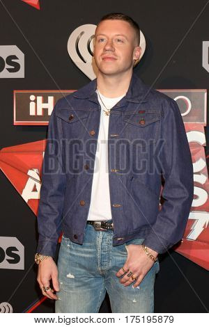 LOS ANGELES - MAR 5:  Macklemore, aka Ben Haggerty at the 2017 iHeart Music Awards at Forum on March 5, 2017 in Los Angeles, CA