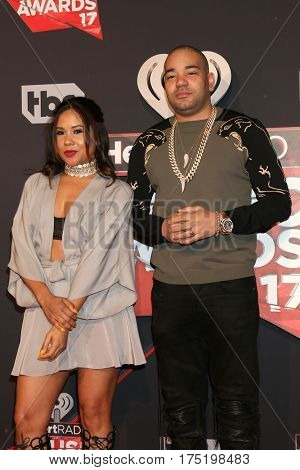 LOS ANGELES - MAR 5:  Angela Yee, DJ Envy at the 2017 iHeart Music Awards at Forum on March 5, 2017 in Los Angeles, CA