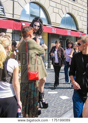 Zurich Switzerland - August 11 2008: Techno parade with transgender drag queen women touching breasts