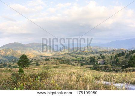 Scenic landscape of rolling hills and grasslands in northeastern Chiapas Mexico near El Chichonal volcano