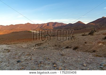 Stone desert with white houses. Desert landscape at sunrise in the national park Cabo de Gata in Andalusia